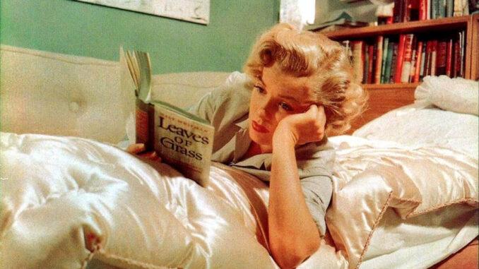 John Florea, Marilyn Monroe reading Leaves of Grass, 1952.